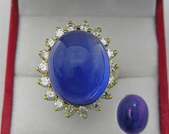 AAAA Blue to Purple Color change Fluorite 28 carats 20x16mm Cabochon 18K yellow gold Diamond halo ring with 1.75 carats of Diamonds  1338