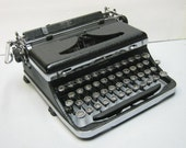 Vintage Working Royal Deluxe Portable Typewriter in Glossy Black Crinkle Finish 1936