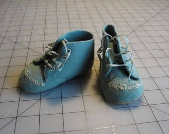 Vintage blue felt baby shoes with embroidery detail