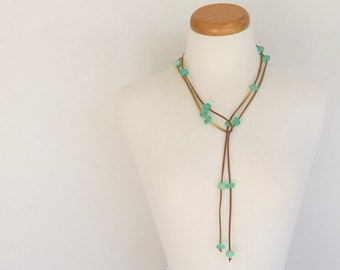 Resin bead lariat necklace mint green resin chip shaped beads spaced along gold suede cord can be worn as a belt too