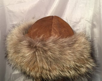 Beautiful Mongolian, Russian, Norse fur hat with brown leather top and coyote fur