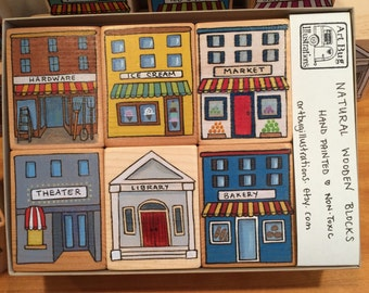 6 hand painted wood blocks in a gift box. Village shops. Store fronts. For all ages.