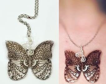 Black & white butterfly resin pendant