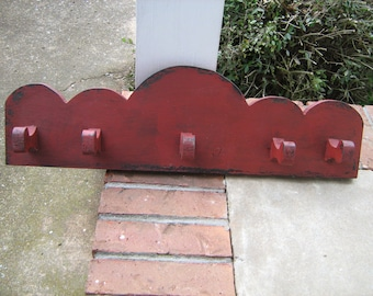 "Primitive red over black hand made 24 "" cap or coat rack"