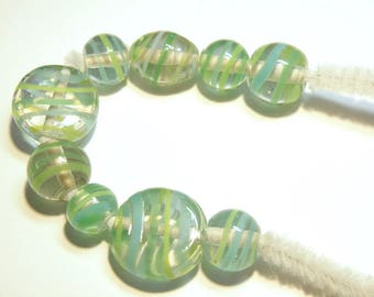 Nine (9) Clear Beads with Yellow/Green/Sky Blue Stripes ---Assorted Shapes --- Lot 3M