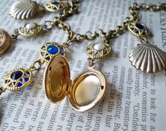 Assemblage necklace - Working lockets and puffy shell charms - Pearl beads - Blue glass stones - One of a Kind -  bycat