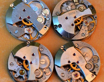 4 or MORE vintage watch movements... Steampunk. Coolvintage Laf T 12