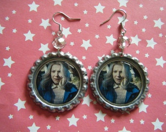 Eleven with blonde wig close up Stranger Things bottle cap earrings with clear faceted glass beads