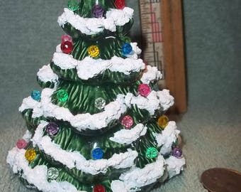 One Pretty Little Green Ceramic Christmas Tree with Multi colored pinlites, with snow and glamour dust