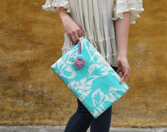 aqua clutch with hand embroidered tassels