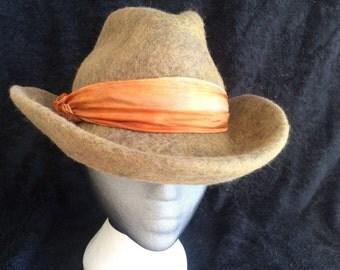 A unisex cowboy/cowgirl wet felted merino wool hat
