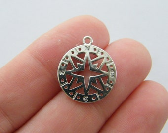 4 Compass charms silver tone SC112
