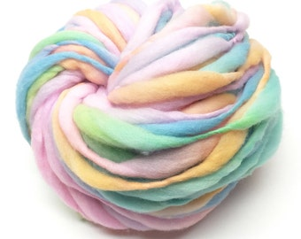 Handspun super bulky yarn, 50 yards and 2.9 ounces, 83 grams, spun super chunky, thick and thin in pastel rainbow  merino wool