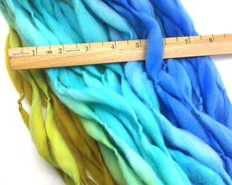 Handspun yarn, 34 yards and 1.8 ounces, 51 grams, spun self striping and thick and thin in hand dyed merino wool