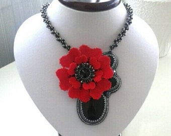 Red beaded flower and black onix cabochon necklace