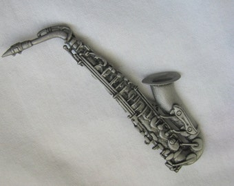 Pewter tone detailed sax instrument brooch pin by JJ