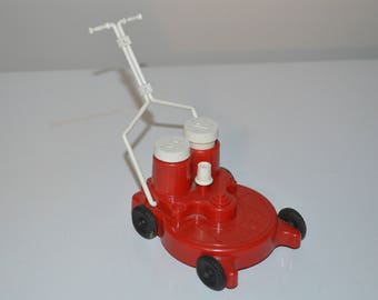 Vintage red and white lawnmower salt and pepper shaker with motion - FUN!