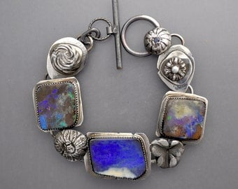 Three Bold Blue Opals with Flowers and a Sapphire Clasp
