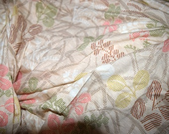 Light pinky beige jersey knit fabric stretch material stretchy floral flowers tropical leaves leaf flower green brown earth earthy beach