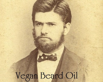 Handsome Gent's Vegan Beard Oil made in small batches and sold in 2 oz. Spray bottles Vanilla, Sandalwood or Bay Rum scented