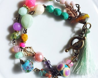 Colorful spring inspired Czech glass abd lampwork beaded bracelet with mint tassel. One of a kind gift for her