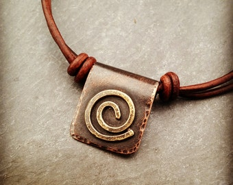 spiral pendant necklace with spiral on copper, handcrafted copper and brass swirl necklace, leather choker, tag pendant adjustable