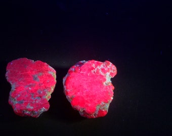 Raw Ruby UV Rough  Glow Ruby. Rough Top Flat Bottom. Strong Red fluorescence. Glows under UV Light.  Raw and Edgy.  2 pc. +/- 20mm  (RU1299)
