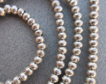 African Silver Spacer Beads