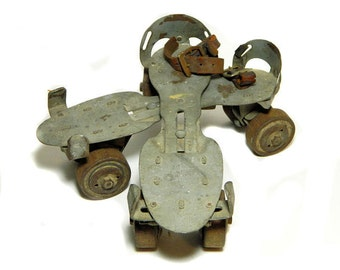 A Pair of Old Union Hardware Metal and Wood Roller Skates