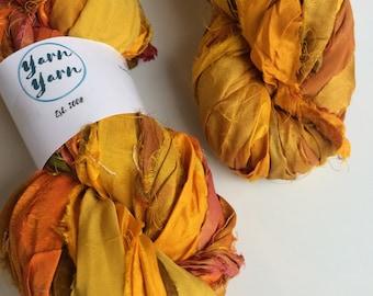 Sari silk ribbon, 300g, knit, beautiful golden yellow. Art yarn, knitting ribbon, ethical yarn. Upcycled yarn.