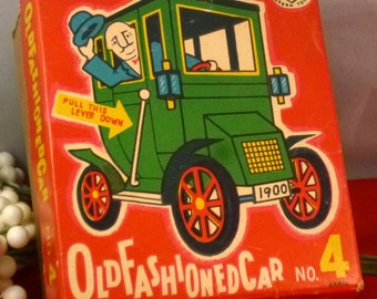 Vintage Lever Action Motor Old Fashioned Car No. 4 by Masudaya Modern Toys, 1950s