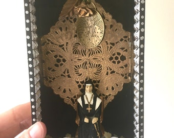 SALE take 20% off Shadowbox wood frame monochrome with vintage nun Mexican style with gold doilie virgin mary pendant // black white gold si