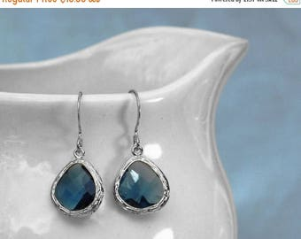 20% off. navy blue earrings with silver plated bezel setting. Framed and faceted