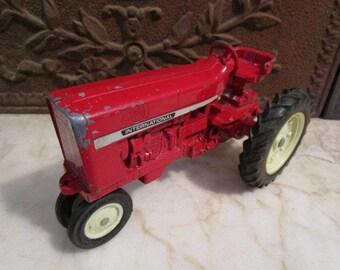 Vintage red, 'International Harvester' farm tractor ERTL, USA!