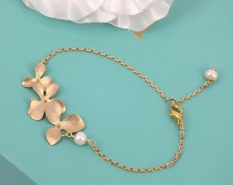 Matte Gold Orchid and Freshwater Pearl bracelet