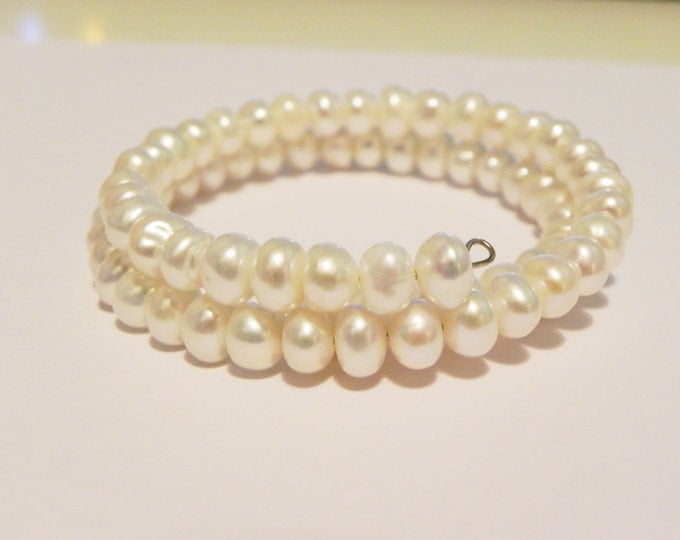 White freshwater pearl rondelle memory wire wrap bracelet.