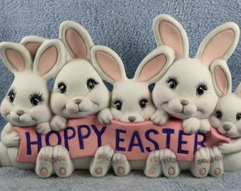 RESERVED FOR CARY Adorable ceramic Easter Bunny Sign with little white rabbits holding a pink and purple Hoppy Easter Sign