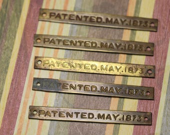 1 Antique Brass 'Patented May, 1873' Label Tag