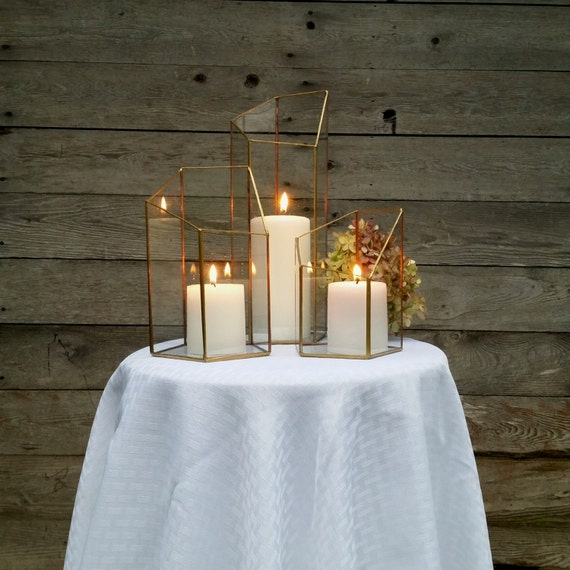 Gold candle holder lighting wedding centerpiece by