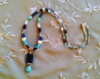 Lapis beaded pendant necklace with white pearl, garnet, turquoise and moonstone