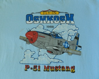 vintage 80s Oshkosh Airplane T Shirt 1988 P-51 Mustang paper thin 50/50 Flying light blue in the clouds L/XL USA made single stitched