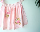 Easter vintage 60s , pastel pink cotton, hand sewn, half apron with a cross stitching embroidery.