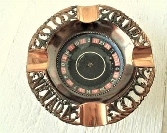 Vintage souvenir ashtray working roulette wheel Reno Nevada copper glass 1950s