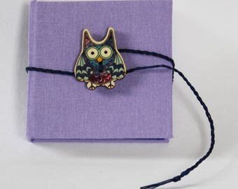 Owl notebook in pretty mauve bookcloth with button and plaited tie fastening, square,blank,white hand stitched and bound pages