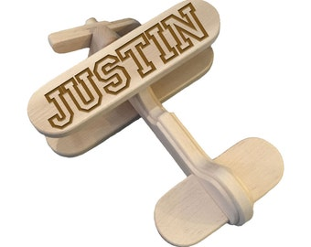 Wooden airplane toy with engraved name, customized with your name. Birth gift