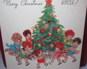 Adorable 1940's colorful Rust Craft Marjorie Cooper christmas card darling children hold hands and dance around christmas tree, santa inside