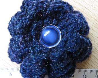 Irish crochet flower brooch in blue wool with vintage blue glass button centre