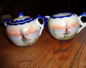 Vintage Cream and Sugar Set with Hand Painted Asian Fishing Scene in Vintage Condition and Made in Japan