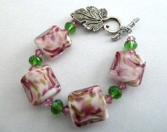 handmade pink and green lampwork bracelet, UK jewellery