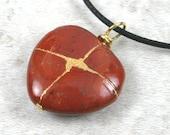 Broken heart pendant in red jasper with gold kintsugi (kintsukuroi) style repair on cotton cord - OOAK